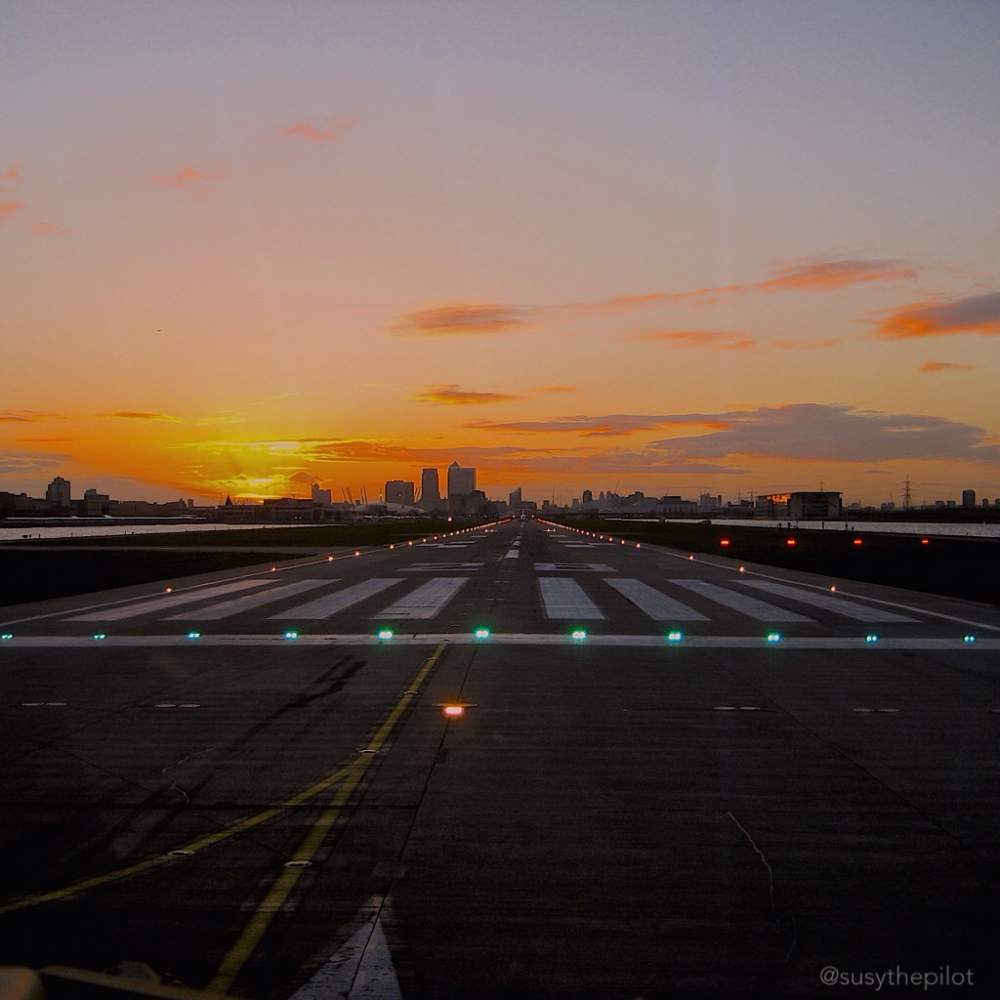 Sunset takeoff London City airport